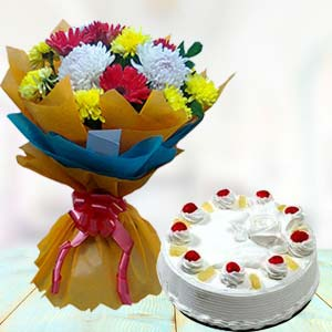 Fresh Mix Flowers With Pineapple Cake: Mothers day Bda Colony,  Bhopal