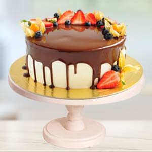 Strawberry Topping Chocolate Cake: Gift Bda Colony,  Bhopal